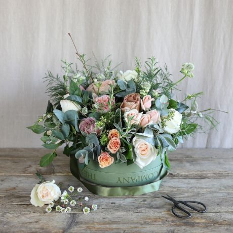 seasonal antique hatbox arrangement