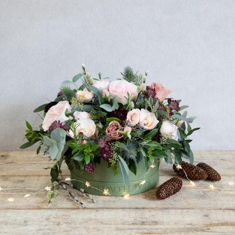 woodland antique christmas flower hat box arrangement