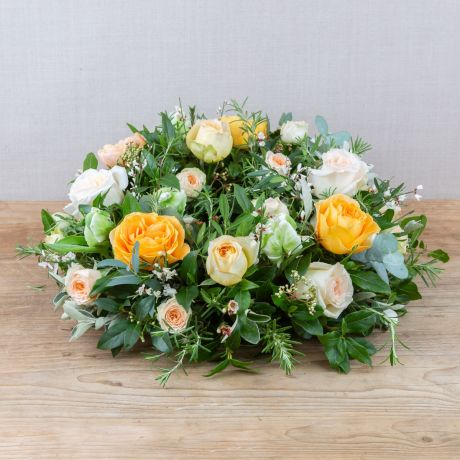 yellow and ivory funeral wreath