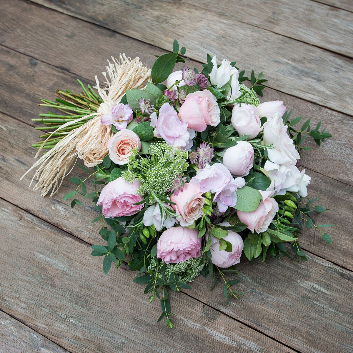 Pastel pink tied funeral sheaf funeral flowers the real flower tap to expand izmirmasajfo