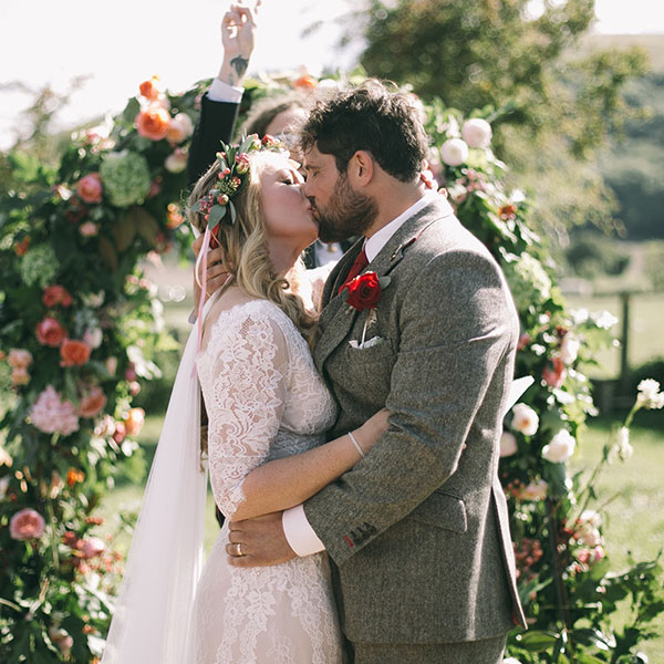 Sam's buttonhole, the floral arch & a beautiful moment